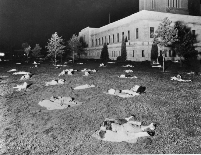The State Capitol Building, Lincoln, With people in street clothes asleep on the lawn during hot days of the 1930's, Picture July 25, 1936